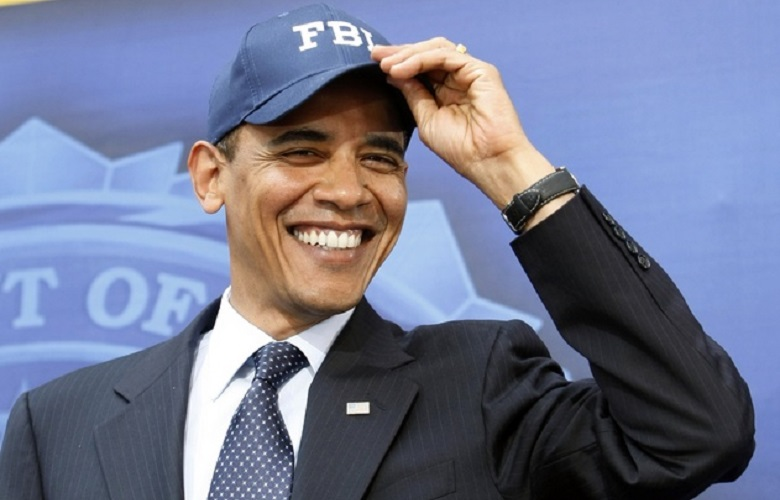 U.S. President Barack Obama receives a cap during his visit to FBI headquarters in Washington
