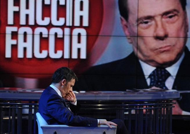 Renzi dal vivo e Berlusconi sul maxischermo di 'Porta a Porta' (Foto AdnKronos)