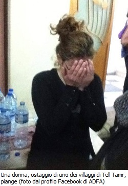 20150224-isis-troops-take-christian-hostages-woman-crying-250x364