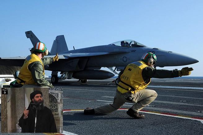 Fase di decollo di un F18-A 'Hornet' dalla portaerei nucleare  USS George H. W. Bush (CVN-77), Classe Nimitz, schierata nel Golfo Persico in carico alla Quinta Flotta americana impegnata nelle operazioni della Coalizione Internazionale contro l'ISIS (Credit photo: Wikipedia)