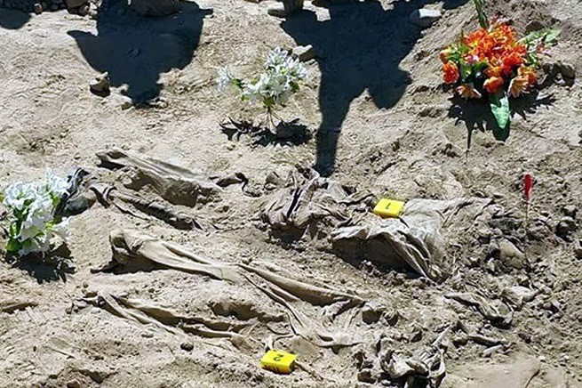 20150528-iraq-tikrit-mass-graves-655x436