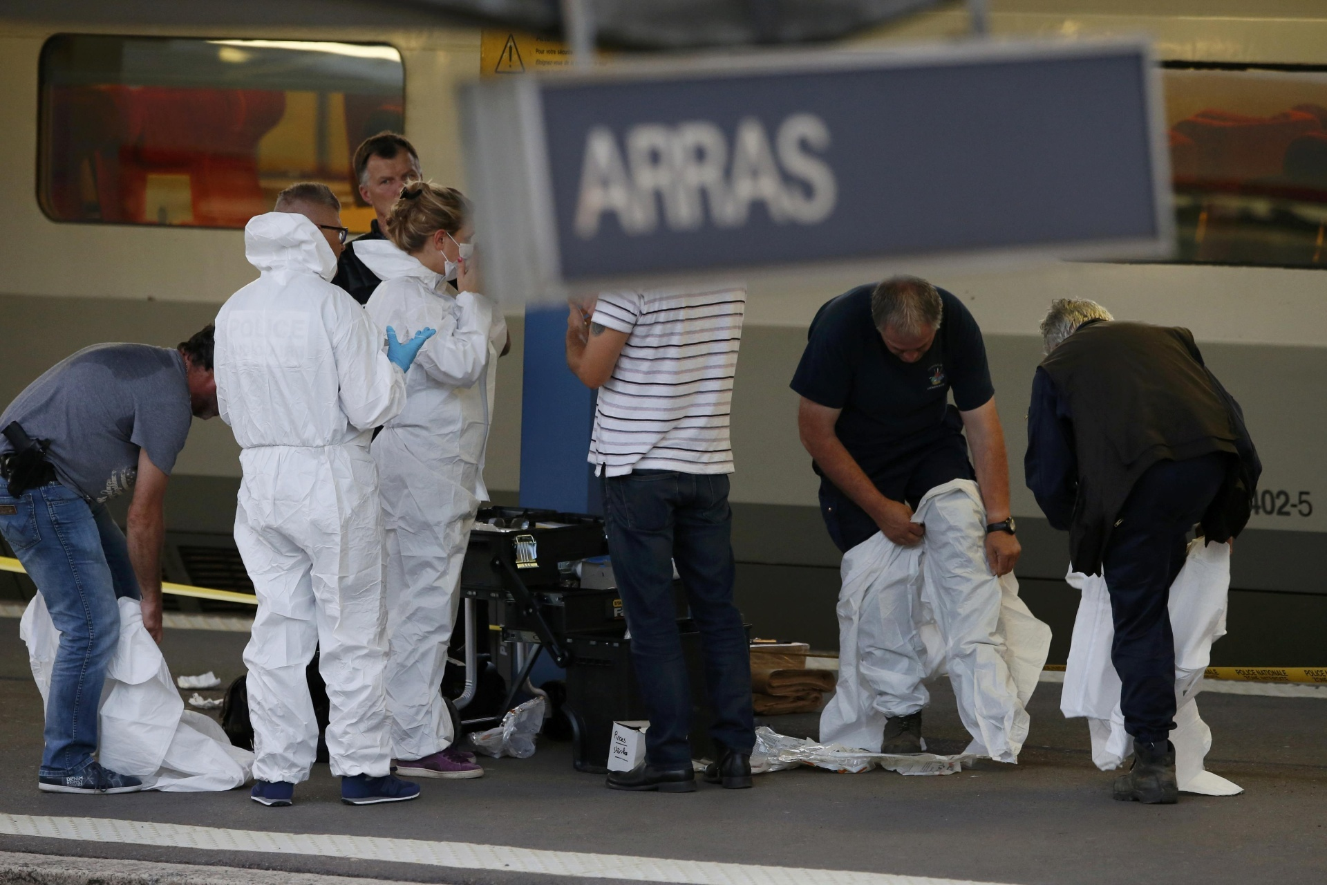 French investigating police in protective clothing prepare to enter Thalys high-speed train where shots were fired in Arras